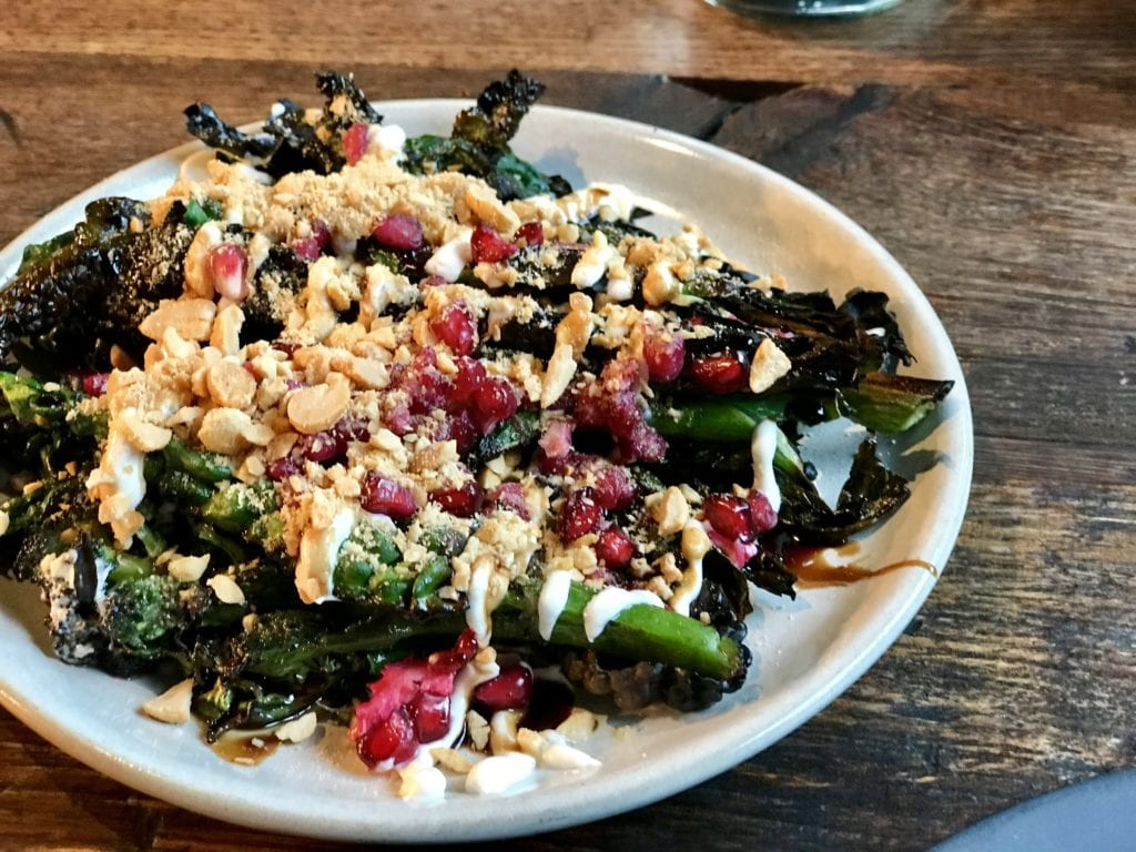 Charred greens with tahini, pomegranate and peanut at Smokestak in Shoreditch